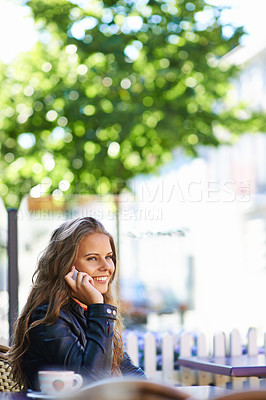 Buy stock photo A beautiful teen talking on her cellphone