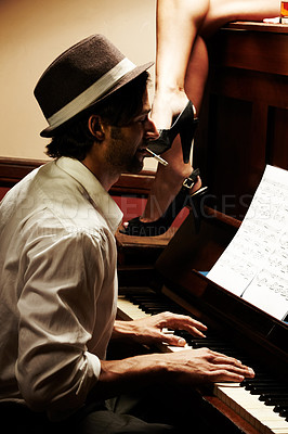 Buy stock photo Profile of a handsome man playing the piano