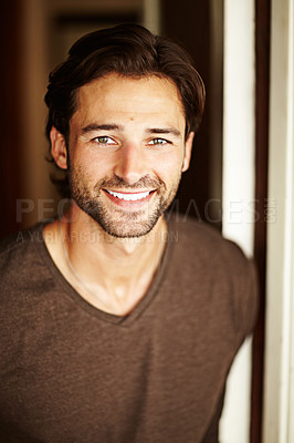 Buy stock photo Portrait of a handsome young man smiling