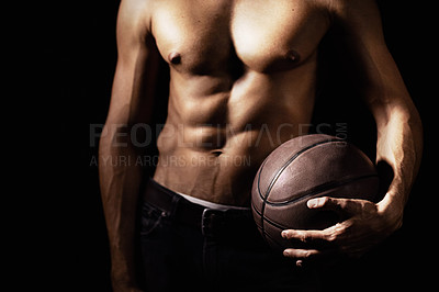 Buy stock photo Cropped image of a muscular young man holding a soccerball