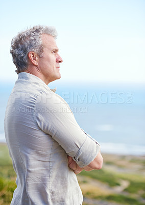 Buy stock photo Portrait of a mature man looking out over the ocean