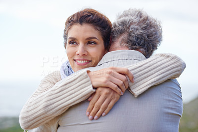 Buy stock photo Rearview shot of a mature man being hugged by his wife