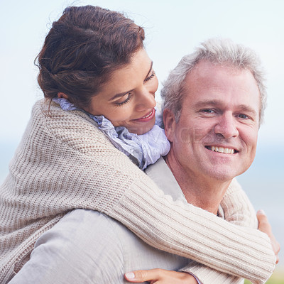Buy stock photo Portrait of a loving mature couple embracing and smiling happily