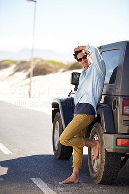 Buy stock photo A young man waiting for roadside assistance