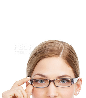 Buy stock photo Studio shot of a beautiful young woman wearing glasses against a white background