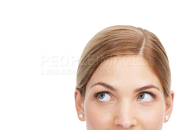 Buy stock photo Closeup studio shot of a beautiful young woman looking thoughtful against a white background