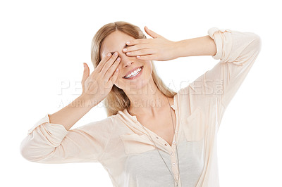 Buy stock photo Studio shot of a beautiful young woman playfully covering her eyes against a white background