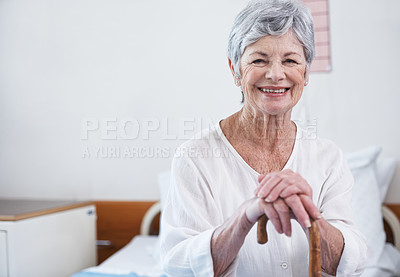 Buy stock photo Portrait of a smiling senior woman sitting in a hospital ward
