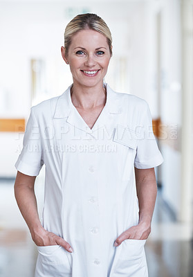 Buy stock photo Portrait of a young medical professional standing in a hospital hallway