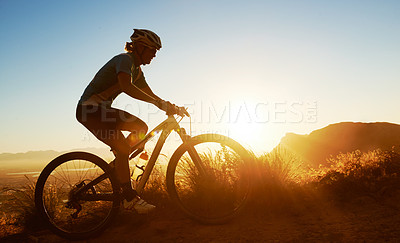 Buy stock photo Full length shot of a woman cycling in the mountains