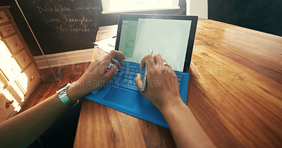 Buy stock photo Cropped shot of a woman's hands using the keyboard on a digital tablet