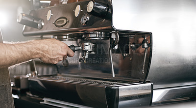 Buy stock photo Closeup shot of a male barista making a cup of coffee