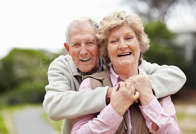 Buy stock photo Portrait of a happy senior man embracing mature woman in countryside