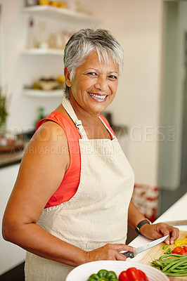 Buy stock photo Portrait of a happy senior woman cooking a healthy meal at home