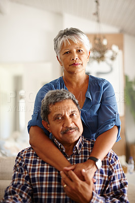 Buy stock photo Shot of a loving senior couple enjoying quality time together at home
