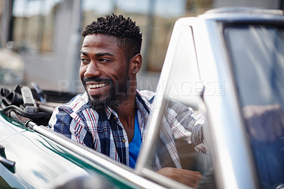 Buy stock photo Shot of a happy young man driving in his convertible