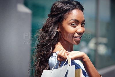 Buy stock photo Portrait of a beautiful woman holding her shopping bags
