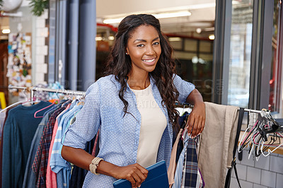 Buy stock photo A young woman posing in front of her cloth