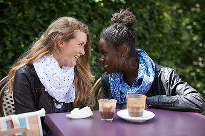 Buy stock photo Shot of two young friends enjoying the day together