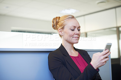 Buy stock photo Cropped shot of an attractive businesswoman using he cellphone on the office