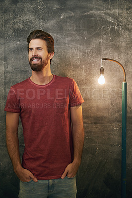 Buy stock photo Cropped shot of a handsome young man standing against a grunge background