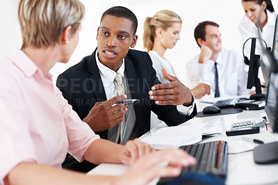 Buy stock photo Group of businesspeople working together and discussing on some business project at office