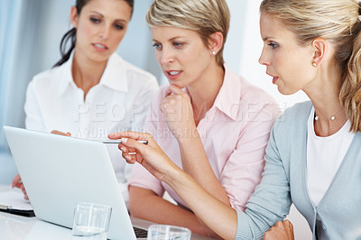 Buy stock photo Portrait of a smart young businesswoman using laptop with his colleagues at office