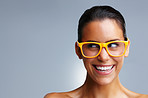 Smiling young woman wearing glasses while looking at copyspace