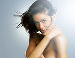 Sensuous naked female against colored background