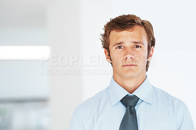 Buy stock photo Portrait of a smart young businessman looking confidently - Copyspace