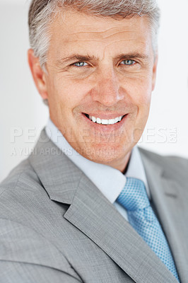 Buy stock photo Closeup portrait of a happy mature businessman smiling