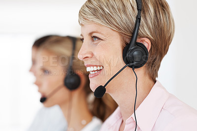 Buy stock photo Portrait of young customer service operator talking on headset and smiling