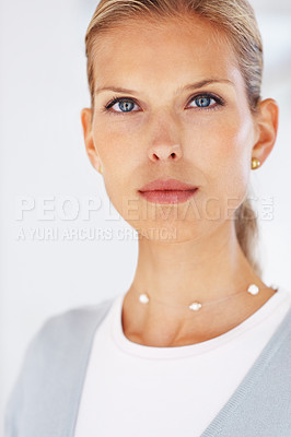 Buy stock photo Portrait of an attractive young business woman looking with attitude
