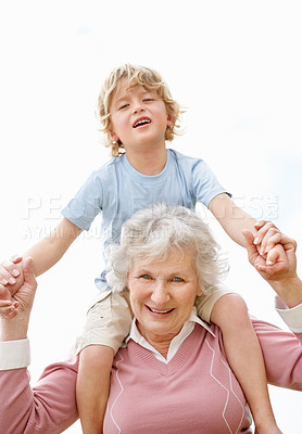 Buy stock photo Portrait of a happy mature woman carrying boy on shoulder isolated against white