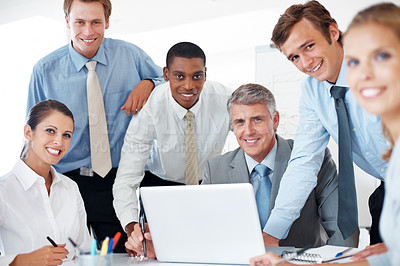 Buy stock photo Portrait of a happy group of businesspeople working together on laptop in a board room