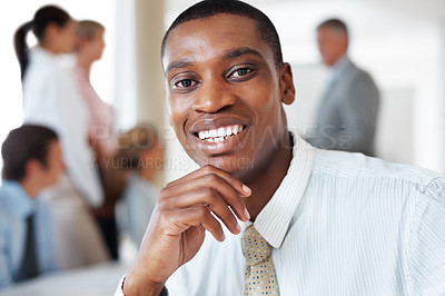 Buy stock photo Closeup portrait of an african american businessman smiling during a presentation at office