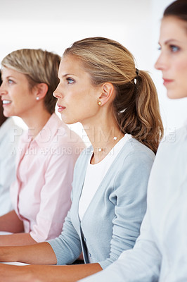 Buy stock photo Group of businesspeople together sitting in a row and attending a meeting at office