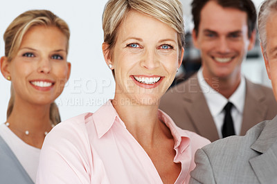 Buy stock photo Portrait of a happy young businesswoman smiling with her group at office