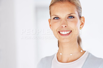 Buy stock photo Portrait of a pretty young female business executive looking happy