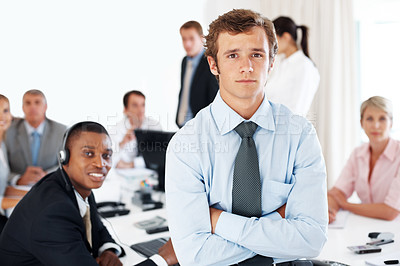 Buy stock photo Smart young  business man with team in background during working hours