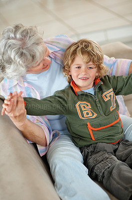 Buy stock photo A young boy sitting on his grandmother's lap