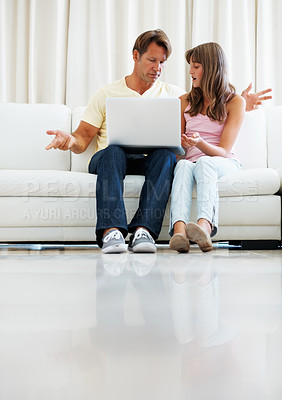 Buy stock photo Full length of father and daughter using laptop at home