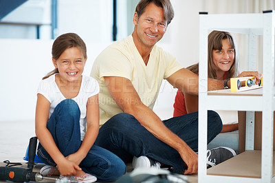 Buy stock photo Portrait of smiling family taking a break from building a shelf