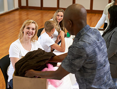 Buy stock photo Cropped shot of a volunteer collecting donations of clothing