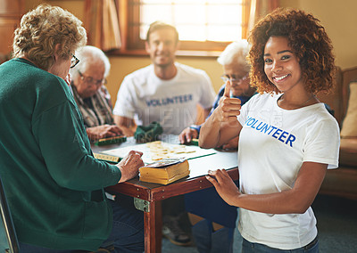 Buy stock photo Portrait of volunteers working with seniors at a retirement home