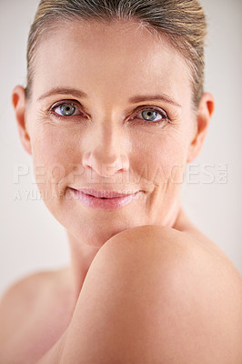 Buy stock photo Cropped portrait of an attractive mature woman posing in studio