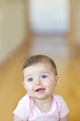 Buy stock photo Portrait of an adorable baby girl sitting on the living room floor