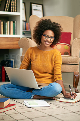 Buy stock photo Full length portrait of a young woman using her laptop to study