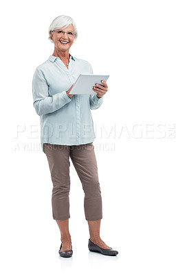 Buy stock photo Studio shot of a senior woman using a digital tablet against a white background