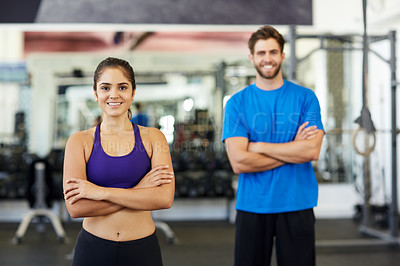 Buy stock photo Cropped shot of two young people standing in the gym